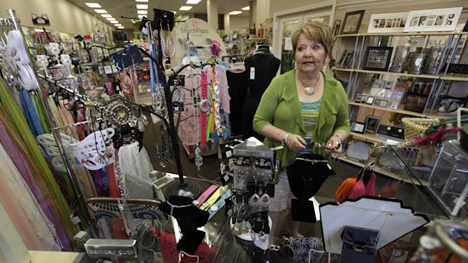 """In this Tuesday, June 19, 2012 photo, Alice Simons talks about the many items she has on display in one of her three stores in Carroll, Iowa. Mitt Romney's private sector resume has impressed Simons. """"I do think he has a little more business sense than Obama does,"""" she says. """"The one thing that really bugs me is people criticize Romney for having money. ... I just want to see successful people. ... I guess what I'm saying if they have made their money in private business, why wouldn't we want somebody that has that sense and know-how?"""" (AP Photo/Charlie Neibergall)"""