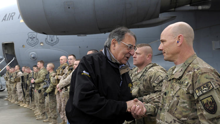 U.S. Defense Secretary Leon Panetta meets with troops at Kabul International Airport in Kabul, Afghanistan, Friday, Dec. 14, 2012, before boarding his plane and heading back to Washington. Panetta spent three days in Afghanistan meeting with troops, commanders and Afghani leaders. (AP Photo/Susan Walsh, Pool)