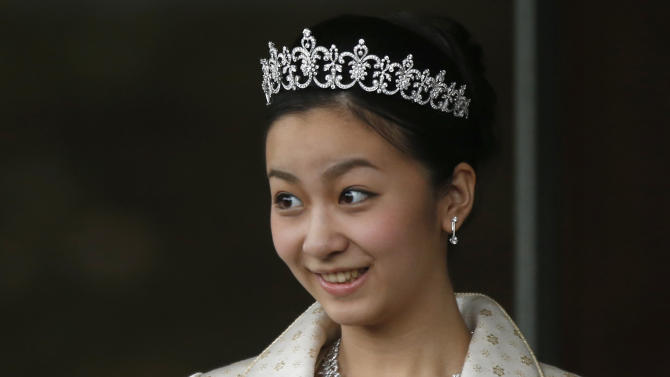 Japan's Princess Kako, the second daughter of Prince Akishino and Princess Kiko, in full dress smiles as she leaves the Imperial Palace after a meeting with Emperor Akihito and Empress Michiko in Tokyo Monday, Dec. 29, 2014. Kako, a granddaughter of Emperor Akihito and Empress Michiko, celebrates her 20th birthday on Dec. 29, 2014. (AP Photo/Issei Kato, Pool)