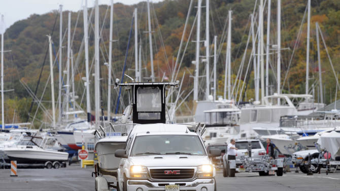 """As Hurricane Sandy moves up the East Coast, owners remove their boats from the water at the Atlantic Highlands Marina, Friday Oct. 26, 2012 in Atlantic Highlands, N.J. When Hurricane Sandy becomes a hybrid weather monster some call """"Frankenstorm"""" it will smack the East Coast harder and wider than last year's damaging Irene, forecasters said Friday. (AP Photo/Joe Epstein)"""