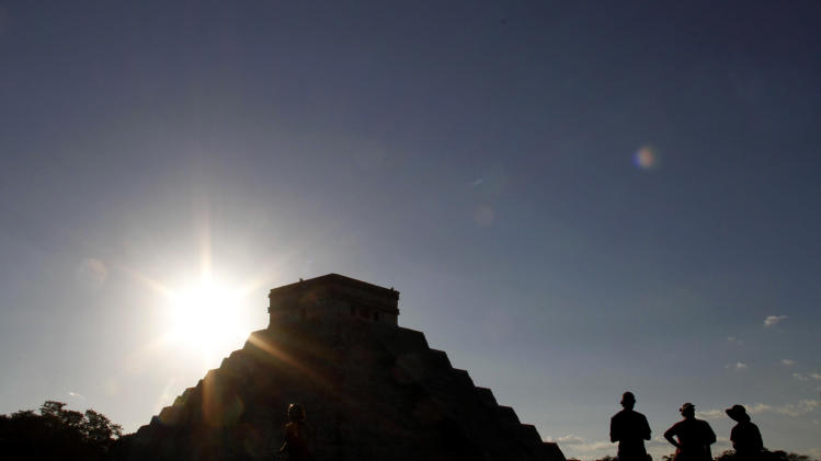 FILE - The sun sets behind the Kukulkan Pyramid in the ancient Mayan city of Chichen Itza in Mexico on Thursday, Dec. 20, 2012. A study published online Thursday, Aug. 1, 2013 by the journal Science says as the world gets warmer, people are more prone to get hot under the collar. Scientists found that aggressive acts like violent crimes and wars become more likely with each added degree. Solomon Hsiang, author of the study, pointed to the collapse of the Mayan civilization that coincided with periods of historic drought about 1200 years ago. (AP Photo/Israel Leal)