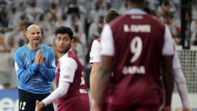 Goalkeeper Saric of Qatar reacts in front of team mates during their round of 16 match against Austria in the 24th men's handball World Championship in Doha