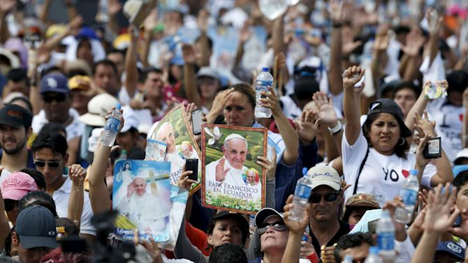 Faithfuls react as Pope Francis (not pictured) gives his blessing after a mass celebrated at Parque Samanes in Guayaquil