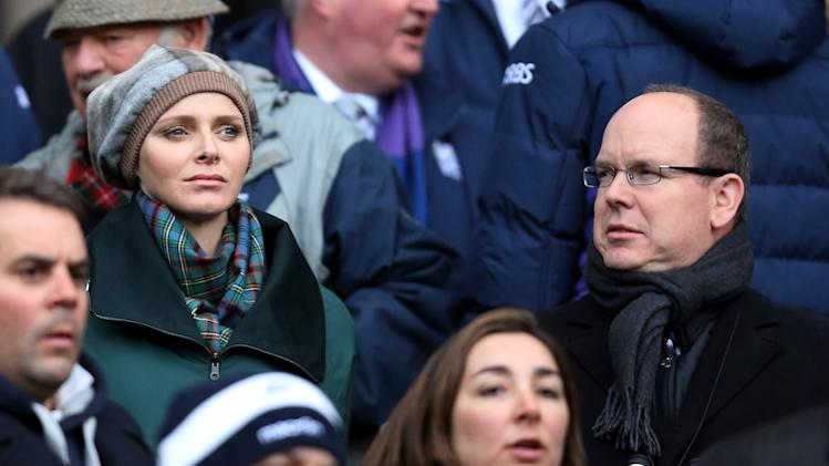 Princess Charlene of Monaco, left, and Prince Albert II of Monaco, right, look on from the stands ahead of the Six Nations rugby union international match between Scotland and France at Murrayfield in Edinburgh, Scotland, Saturday March 8, 2014. (AP Photo/Scott Heppell)