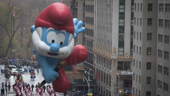 The Papa Smurf float makes its way down 6th Ave during the Macy's Thanksgiving Day Parade, in New York
