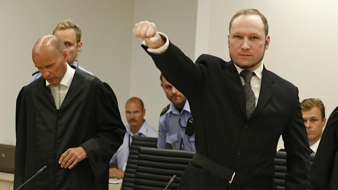 Mass murderer Anders Behring Breivik, makes a salute after  arrives at the court room in a courthouse in Oslo  Friday Aug. 24, 2012 .   Breivik, who admitted killing 77 people in Norway last year, declared sane and sentenced to prison for bomb and gun attacks. (AP Photo/Heiko Junge / NTB scanpix, Pool)