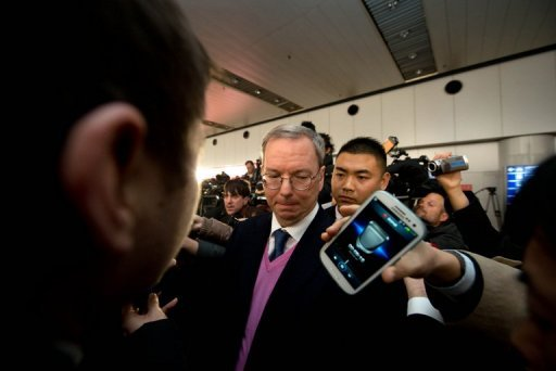 &lt;p&gt;Google chairman Eric Schmidt (C) is seen surrounded by the media after arriving in Beijing from North Korean capital Pyongyang, on January 10, 2013. Schmidt told North Korean officials their country would never develop unless it embraced Internet freedom, he said as he returned from his trip.&lt;/p&gt;
