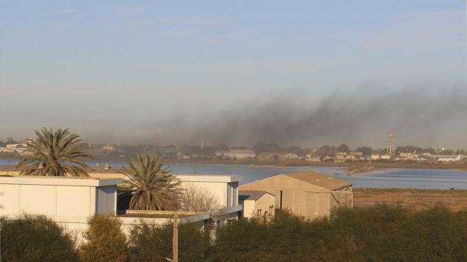 Smoke rises after an airstrike hit Maitiga airport early Thursday morning, in Tripoli