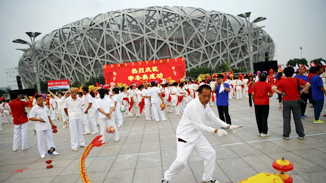 People celebrate after Beijing was chosen to host the 2022 Winter Olympics at the Bird's Nest Olympic stadium in Beijing