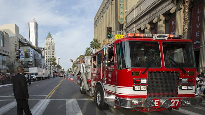 """Cast member Johnson rides a Los Angeles Fire Department engine as he arrives at the premiere of """"San Andreas"""" in Hollywood"""
