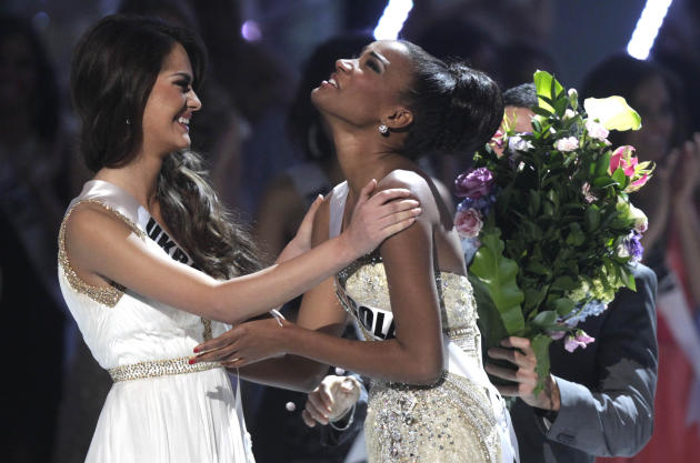 Miss Angola Leila Lopes, right, and Miss Ukraine Olesia Stefanko react after Lopes was named Miss Universe 2011 and Stefanko first runner up at the Miss Universe pageant in Sao Paulo, Brazil, Monday S