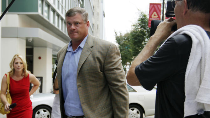 FILE - In this July 25, 2011, file photo, former offensive lineman Pete Kendall arrives at the NFL Players Association offices in Washington. In recent interviews with 40 players _ 13 rookies, 17 active veterans and 10 former NFL players _ The Associated Press heard growing worry about the physical and emotional toll professional football takes. The 43-year old former NFL linebacker Junior Seau's suicide at his oceanfront home on May 2, 2012, resonated across the age groups, with more than half of each saying that particular event pushed them to ponder their future in the sport or the difficulties of adjusting to a new daily life after leaving the league. (AP Photo/Carolyn Kaster, File)