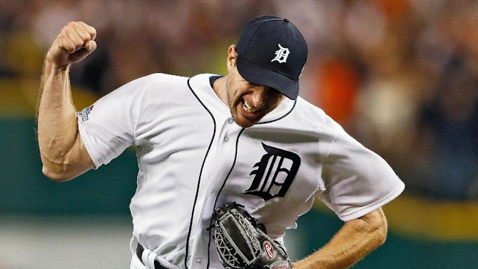 Detroit Tigers pitcher Max Scherzer celebrates after Oakland Athletics' Alberto Callaspo lined out to center for the last out of the eighth inning in Game 4 of baseball's American League division series in Detroit, Tuesday, Oct. 8, 2013. The Tigers won 8-6. (AP Photo/Grand Rapids Press, Mike Mulholland) LOCAL TV OUT LOCAL INTERNET OUT