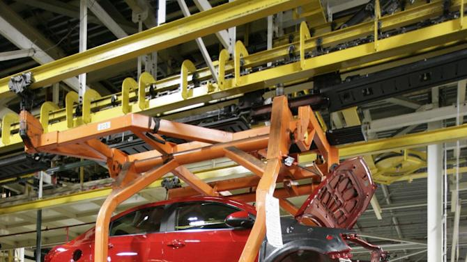 In this April 25, 2012 photo, a drive train assembly moves in to be mated with a Chevrolet Sonic at the Orion Assembly plant in Orion Township, Mich. Nearly four years after GM filed for bankruptcy protection, the automaker is building the Sonic, the best-selling subcompact car in the nation. (AP Photo/Duane Burleson)
