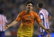 Barcelona&#39;s forward Lionel Messi celebrates after scoring during a Spanish league football match against Deportivo La Coruna at Riazor Stadium in Coruna. Messi hit his 21st Barcelona hat-trick as his 10-man side edged a thrilling 5-4 victory at Deportivo La Coruna