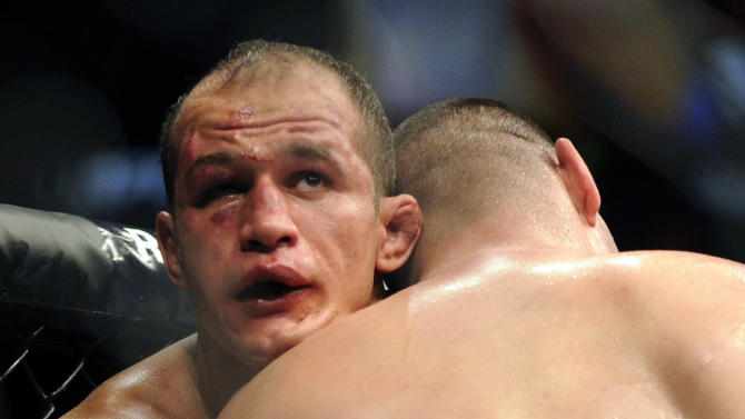 Junior dos Santos of Brazil, left, and Cain Velasquez of San Jose grapple during their UFC 155 heavyweight championship mixed martial arts match at the MGM Grand Garden Arena Saturday, Dec, 29, 2012 in Las  Vegas. Velasquez won with a unanimous decision. (AP Photo/David Becker)