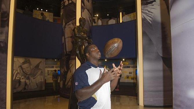 St. Louis Rams rookie Greg Robinson flips a replica 1906 football, during the 2014 NFL Rookie Symposium at the Pro Football Hall of Fame in Canton, Ohio, Wednesday, June 25, 2014