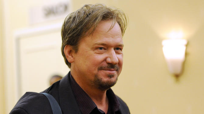 In this June 20, 2014, file photo, Frank Schaefer, a United Methodist Church pastor who was defrocked for officiating his son Tim's wedding to another man, arrives for a Methodist judicial panel appeal hearing on his defrocking in Linthicum, Md. A nine-person church appeals panel on Tuesday, June 14, 2014, overturned the church's decision to defrock Schaefer, who was pastor of Zion United Methodist Church of Iona in Lebanon, Pa. (AP Photo/Steve Ruark, File)
