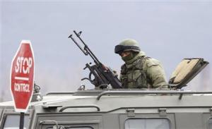 An armed man, believed to be Russian serviceman, is …