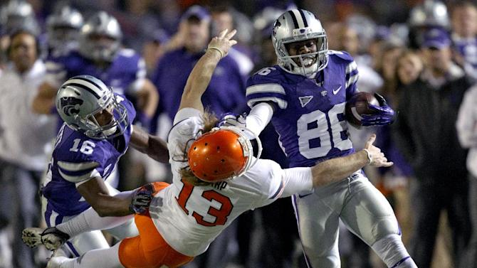 Kansas State wide receiver Tramaine Thompson (86) is forced out of bounds by Oklahoma State kicker Quinn Sharp (13) during the second half of an NCAA college football game in Manhattan, Kan., Saturday, Nov. 3, 2012. Kansas State wide receiver Tyler Lockett (16) blocks on the play. Kansas State defeated Oklahoma State 44-30. (AP Photo/Orlin Wagner)