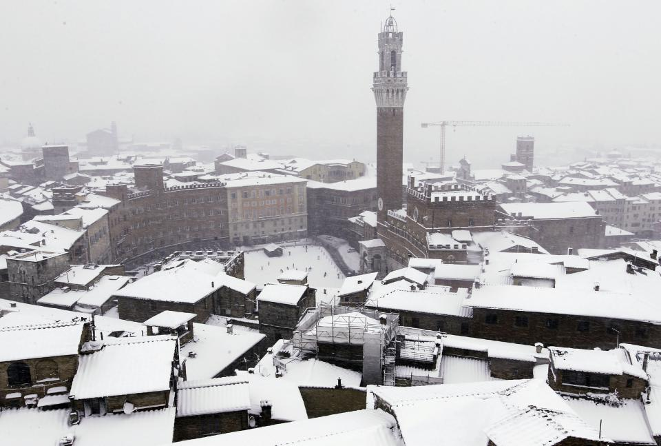A view of the city of Siena, central Italy, blanketed in snow, as snowfalls have been battering the country, Wednesday, Feb. 1, 2012. (AP Photo/Paolo Lazzeroni)