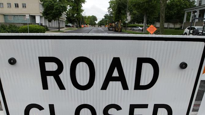 """FILE - This April 30, 2012 file photo shows a """"road closed"""" construction sign in Springfield, Ill. Here are a few items that have been largely missing in the presidential campaign: planes, trains, roads and bridges. Most of the nation's transportation network was built in the last century, and in some places dates back to the 1800s. Our aging highways, bridges, trains and buses are frequently in need of repair or replacement, and no longer can handle peak traffic demands. More than 140,000 bridges are structurally deficient or obsolete. And the problem will only worsen as the nation's population grows. (AP Photo/Seth Perlman, File)"""