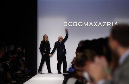 Designer Max Azria acknowledges the crowd as he waves at the BCBG Max Azria Autumn/Winter 2013 collection during New York Fashion Week February 7, 2013. REUTERS/Joshua Lott