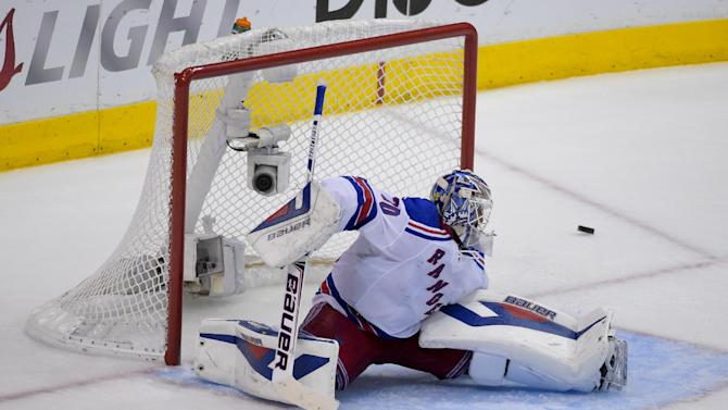 New York Rangers goalie Henrik Lundqvist, of Sweden, blocks a shot by the Los Angeles Kings during the third period in Game 5 of an NHL hockey Stanley Cup finals, Friday, June 13, 2014, in Los Angeles