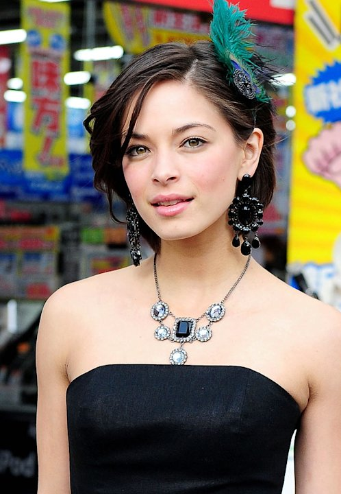 "Kristin Kreuk poses for photographers at Akihibara shopping street on February 12, 2009 in Tokyo, Japan. Kreuk is in Tokyo to promote her latest film ""Street Fighter: The Legend of Chun-Li ""."