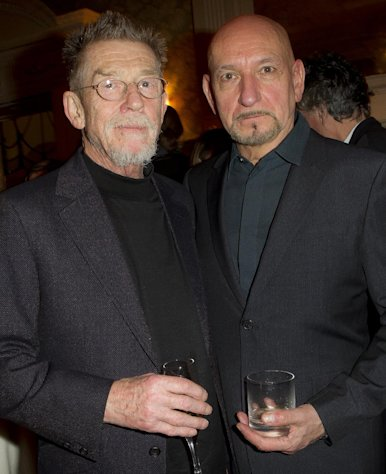 British actors John Hurt and Sir Ben Kingsley pose for photographs during a pre Bafta drinks reception for director Martin Scorsese at Claridges in London, Friday, Feb. 10, 2012. Scorsese receives the Bafta Fellowship award during the ceremony on Sunday. (AP Photo/Joel Ryan)