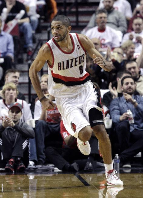 Portland Trail Blazers forward Nicolas Batum, from France, heads downcourt during the second half of an NBA basketball game against the San Antonio Spurs in Portland, Ore., Saturday, Nov. 2, 2013. Bat