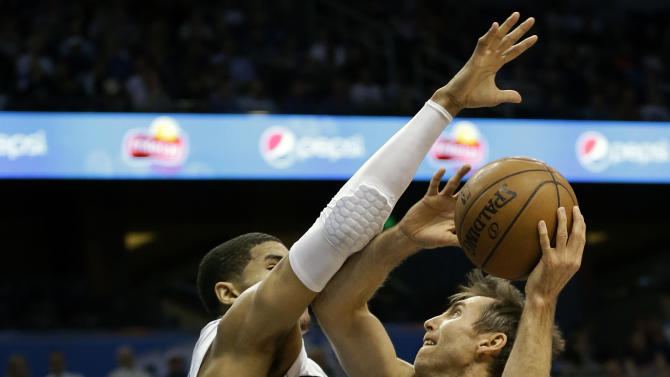 Los Angeles Lakers' Steve Nash, right, attempts a shot over Orlando Magic's Tobias Harris, left, during the first half of an NBA basketball game, Tuesday, March 12, 2013, in Orlando, Fla. (AP Photo/John Raoux)