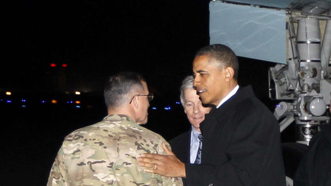 "President Barack Obama is greeted by Lt. Gen. Curtis ""Mike"" Scaparrotti, and U.S. Ambassador to Afghanistan Ryan Crocker as he steps off Air Force One at Bagram Air Field in Afghanistan, Tuesday, May 1, 2012. (AP Photo/Charles Dharapak)"