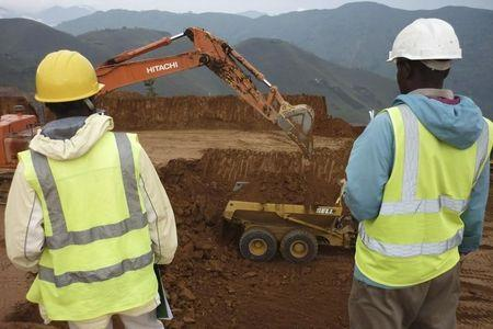 Employees stand in an open pit at Banro's Twangiza mine in eastern Congo