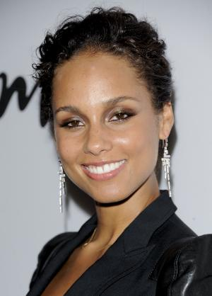"""FILE - In this Sept. 26, 2011 file photo, Alicia Keys attends the Lifetime and Sony Pictures Television premiere screening """"Five"""" at Skylight SoHo in New York. Keys will produce as well as compose original music for the Broadway premiere of """"Stick Fly,"""" opening Dec. 8, at the Cort Theatre in New York.  (AP Photo/Evan Agostini, file)"""