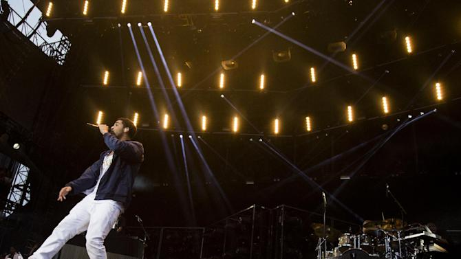 """Drake performs at the """"Made In America"""" music festival on Sunday, Sept. 2, 2012, in Philadelphia. (Photo by Charles Sykes/Invision/AP)"""