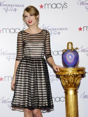 "American country singer Taylor Swift launches her debut fragrance, ""Wonderstruck"", at Macy's Herald Square on Thursday, Oct. 13, 2011 in New York. (AP Photo/Evan Agostini)"