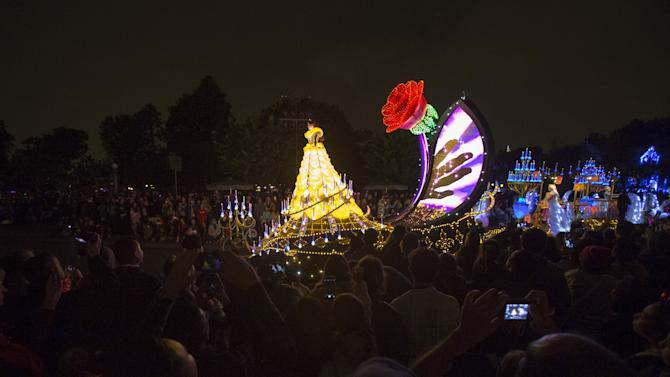 "People watch a float featuring Disney princesses during the ""Paint the Night - All-New Electrical Parade"" during Disneyland's Diamond Celebration in Anaheim"