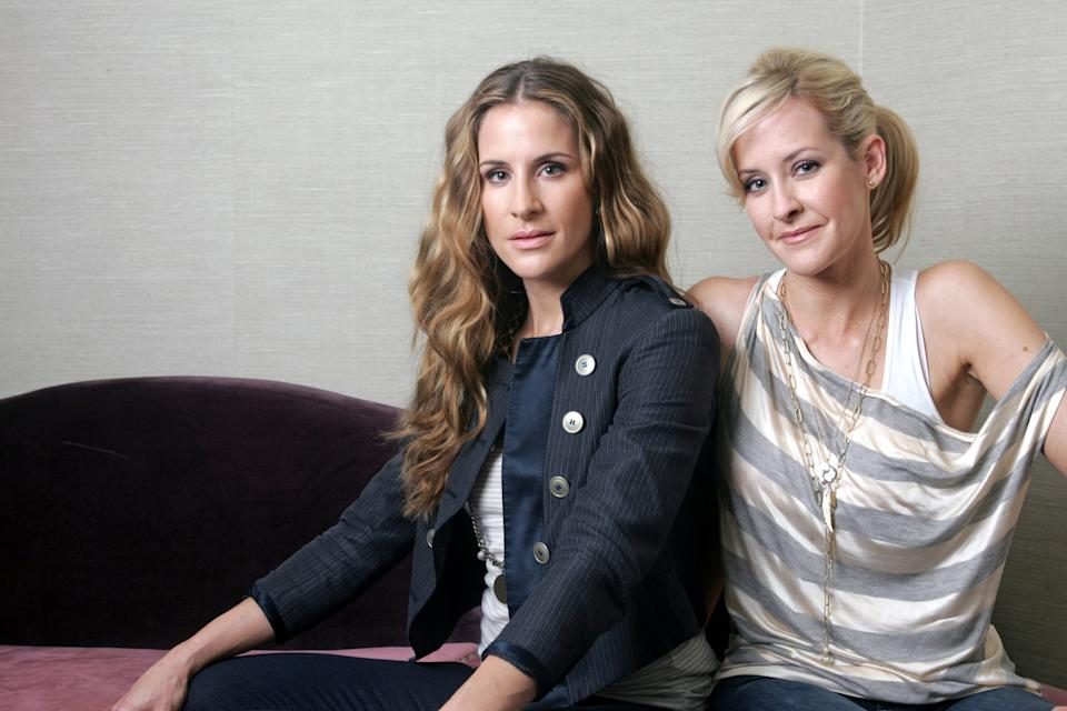 FILE - In this March 23, 2010 file photo, sisters Emily Robison, left, and Martie Maguire of the Court Yard Hounds are shown in New York. The Court Yard Hounds will perform at the Lollapalooza music festival from Aug. 2 - 4 at Grant Park in Chicago. (AP Photo/Bruce Gilbert, File)