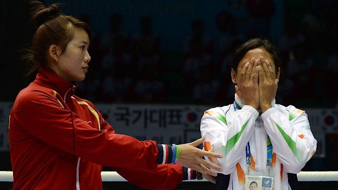 Sarita Devi (R) after she refused to accept her bronze medal for the women's lightweight (57-60kg) boxing at the 2014 Asian Games, October 1, 2014
