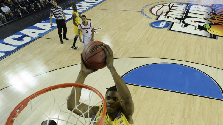 Michigan forward Glenn Robinson III (1) dunks the ball against the Louisville during the second half of the NCAA Final Four tournament college basketball championship game Monday, April 8, 2013, in Atlanta. (AP Photo/NCAA Photos, Chris Steppig)