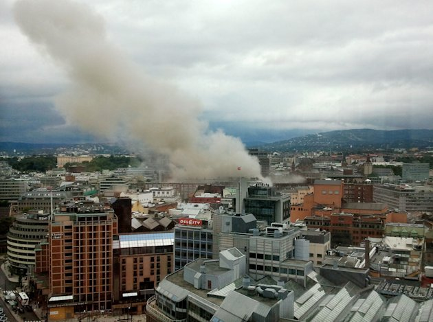 Smoke rises from the central area of Oslo Friday, July 22, 2011 after an explosion. Terrorism ravaged long-peaceful Norway on Friday when a bomb ripped open buildings including the prime minister&#39;s office and a man dressed as a police officer opened fire at a nearby island youth camp. (AP Photo/Scanpix, Jon Bredo Overaas) NORWAY OUT