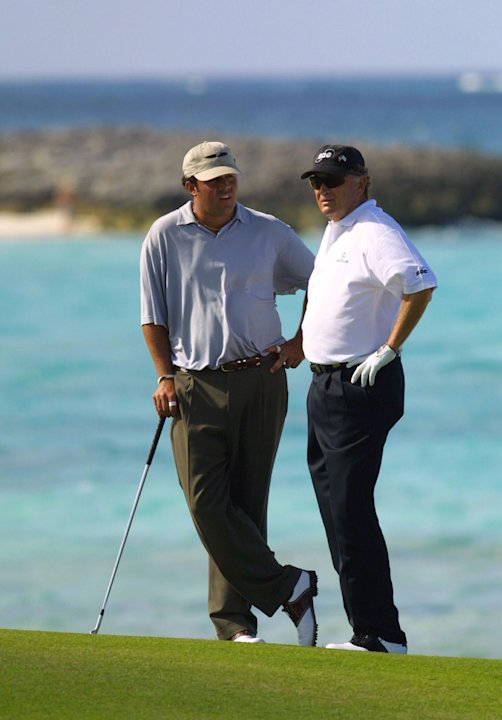 Raymond Floyd, right, and his son, Robert, talk on the 17th fairway Sunday Dec. 2, 2001 during the Office Depot Father/Son Challenge at the Ocean Club Golf Course on Paradise Island in the Bahamas. Th