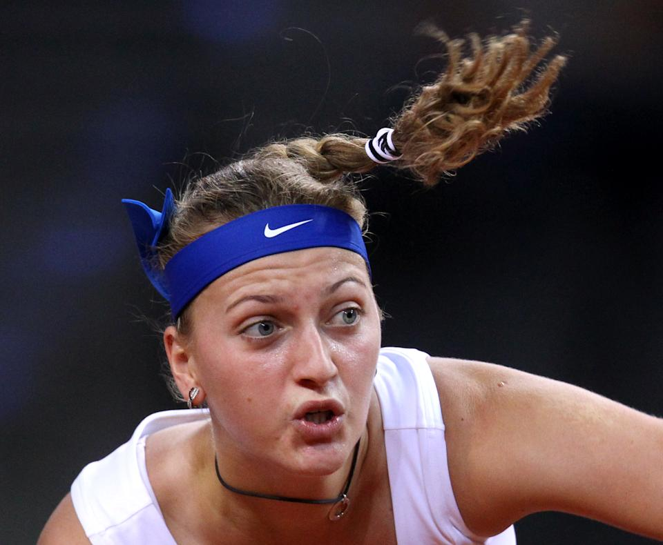 Czech Petra Kvitova serves against Russia's Maria Sharapova during their semifinal match at the Porsche Tennis Grand Prix in Stuttgart, Germany, Saturday, April 28, 2012. (AP Photo/Michael Probst)