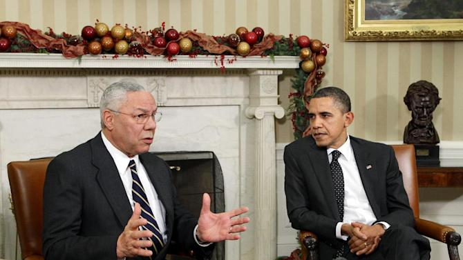"""FILE - In this Dec. 1, 2010 file photo, former Secretary of State Colin Powell meets with President Barack Obama, in the Oval Office at the White in Washington. Powell, a longtime Republican said on the """"CBS This Morning"""" program Thursday, he is sticking with President Barack Obama in this year's election.  (AP Photo/J. Scott Applewhite, File)"""