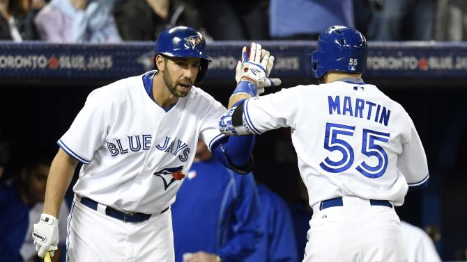 Toronto Blue Jays' Russell Martin celebrates his home run against New York Yankees starting pitcher CC Sabathia with teammate Chris Colabello during sixth inning American League baseball action in Toronto, Wednesday, May 6, 2015. (Frank Gunn(/The Canadian Press via AP) MANDATORY CREDIT