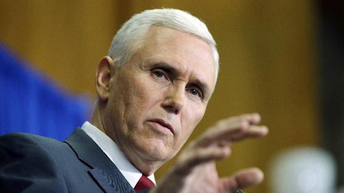 Indiana Gov. Mike Pence speaks question during a news conference, Tuesday, March 31, 2015, in Indianapolis. Pence said that he wants legislation on his desk by the end of the week to clarify that the state's new religious-freedom law does not allow discrimination against gays and lesbians. (AP Photo/Darron Cummings)