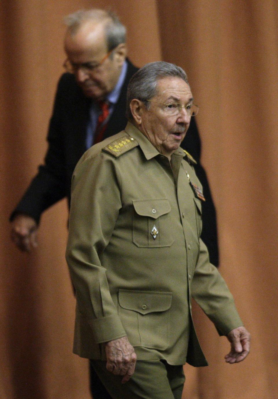 Cuba's President Raul Castro arrives followed by Ricardo Alarcon, president of the National Assembly, for the start of a session in Havana, Cuba, Thursday, Dec. 13, 2012. The session is one of the National Assembly's twice-yearly gatherings. (AP Photo/Ismael Francisco, Cubadebate)