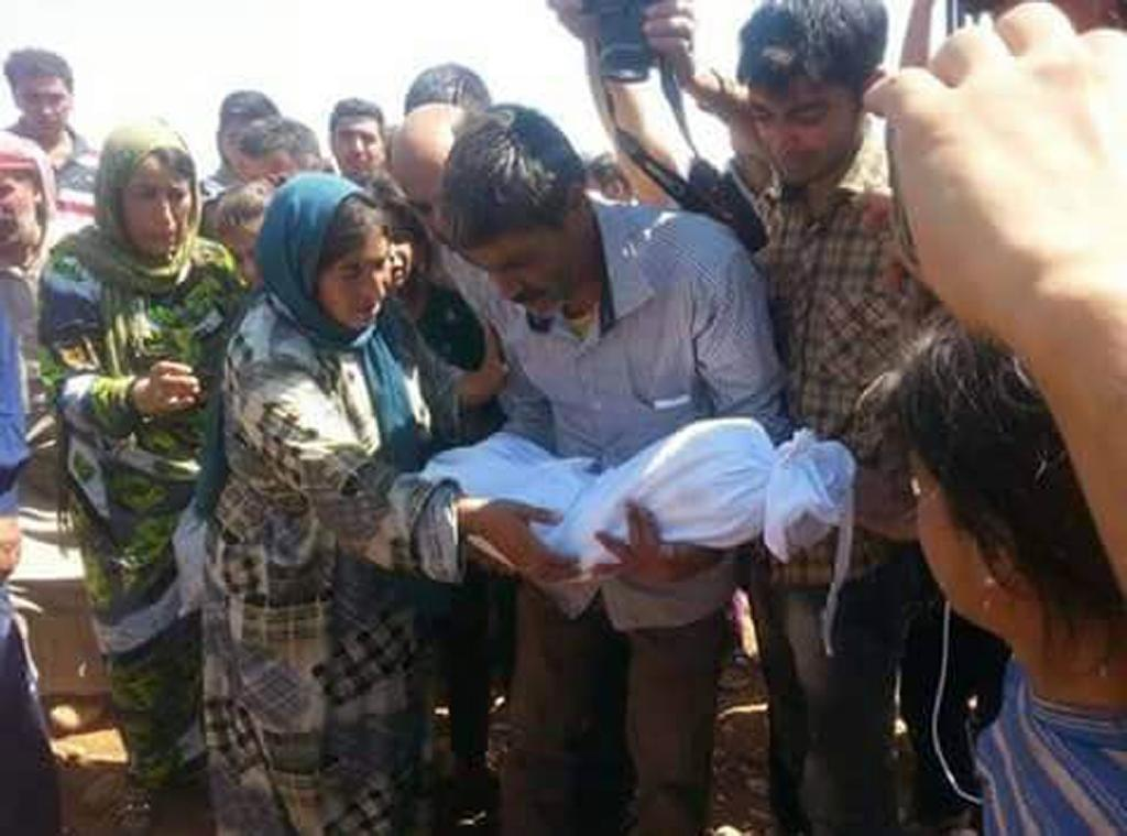 Father buries his drowned toddler, family in Syria