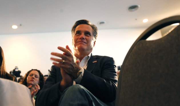 Republican presidential candidate, former Massachusetts Gov. Mitt Romney applauds introductory speakers before he speaks at the Ingham Lincoln Day Breakfast in Lansing, Mich., Saturday, Feb. 25, 2012. (AP Photo/Gerald Herbert)